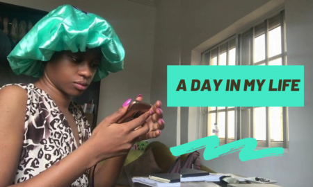 African blogger scrolling through her phone as she shows off a day in my life.