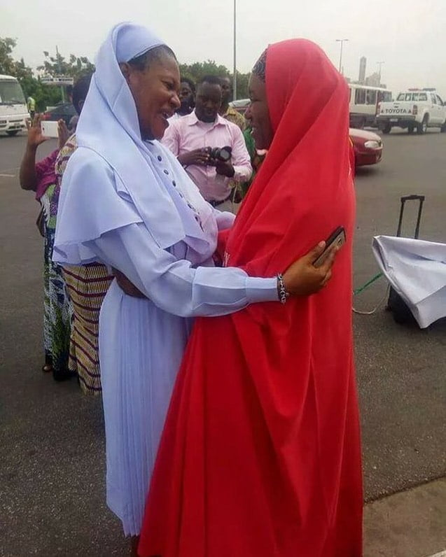moslem and christian hugging each other; Aisha Yesufu