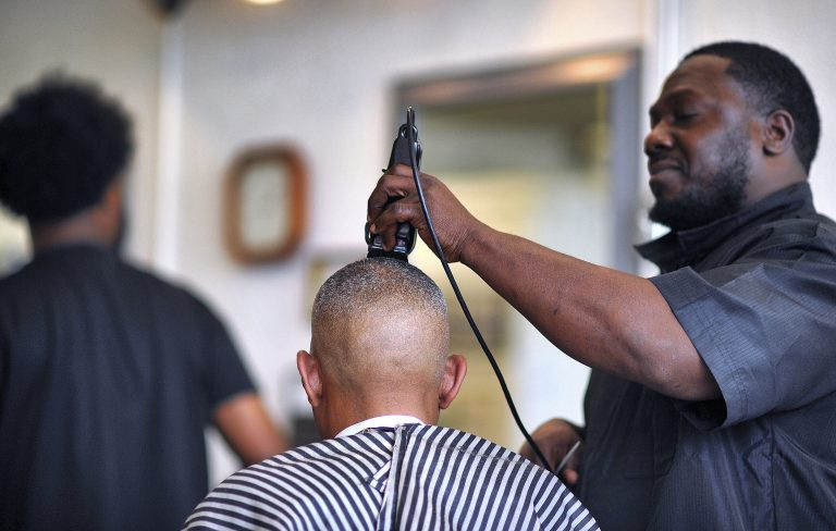 an African barber at his studio