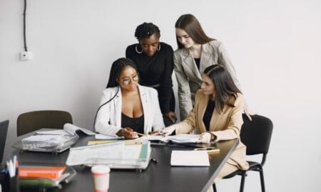 young women discussing ways to improve their money habit